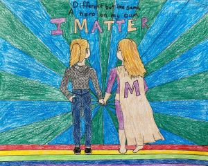 "Marieke's artwork shows two apparently female figures holding hands, with the inscription, ""Different but the same, A hero on my own, I MATTER"""